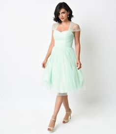 Perfect for your next garden party or afternoon tea, this retro mint green and white swiss dotted cocktail dress will gi...Price - $138.00-MHd0rPiu