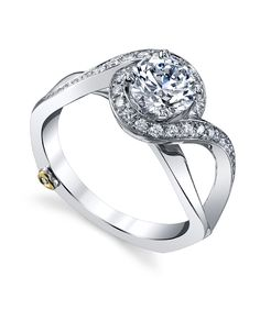 The Mystify engagement ring contains 33 diamonds, totaling 0.245ctw. Center stone sold separately, not included in price.  The Mystify wedding band contains 9 diamonds, totaling 0.035ctw.