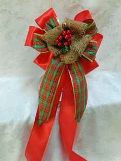 Country Christmas Red Satin, plaid and burlap wedding/pew bow with red berries center. $12.00, via Etsy.