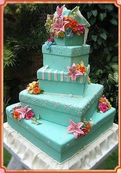 Floral Cake  A square aqua blue wedding cake with flowers.