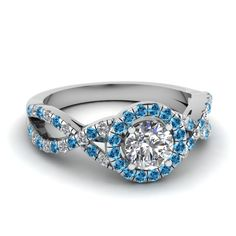 Halo Plait Ring    Round Cut Diamond Halo Ring With Ice Blue Topaz In 14k White Gold