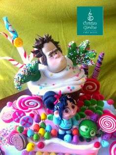 A triumph od sweeties for a sweet little girl, in love with Wreck-it Ralph and his crew! The cake is totally handmade with Sugarpaste and real candies!