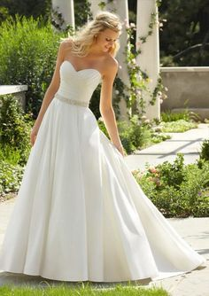 The perfect gown for ANY themed wedding and D.J.'s favorite; the Morilee luxe taffeta A-Line with a ruched sweetheart neckline and the best part... Pockets! You can find this dress here at Alicia's Bridal.