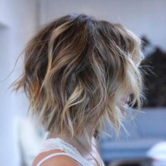 Use texturizing spray and scrunch while drying, then use curling iron on a few sections. Shaggy Brown Bob With Blonde Balayage