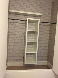 IKEA kallax hack - built in wardrobe and brick wallpaper