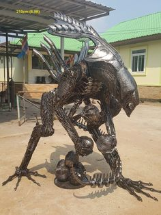 Alien queen statue, protecting its eggs, life size scrap metal art made in Thailand