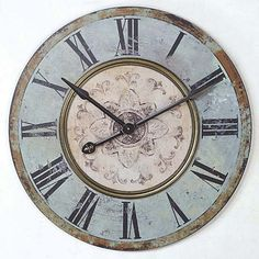 """Circular, with an artistic and femininely painted center, this lightly distressed wall clock displays the time via large hands with arrow points and a fleur de lis detail. brbrliDimensions: 29"""" ..."""