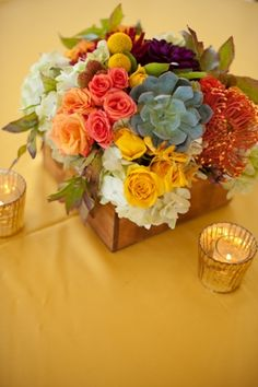 wedding flower centerpiece bright colors yellow orange green at Shabby Chic City wedding in Dallas at the Room on Main by Nine Photography on Marry Me Metro Blog marrymemetro.com #loft #wedding #ideas #shabby #chic #vintage #modern #dallas #wedding #flowers #tables