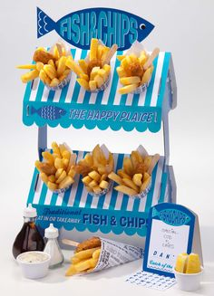 This is perfect for your very own beach themed party with a traditional party size Fish & Chip Stall. This is perfect for any celecbration.   Pack includes  1 x card stand 12 x newspaper print paper chip cones 1 x A Board sign with sticky letters to personalise  which reads fish & chips & catch of the day at the bottom. This quality card stand comes flat packed, Stand when assembles measures 40 cm tall, 30 cm wide, 24.5 cm deep.