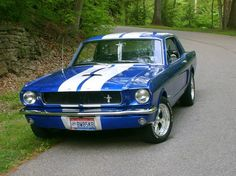 1965 Ford Mustang....I want this car!! :) Brings back memories of my Papaw drivin me around in his red one