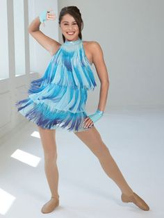 9948e41f20f9 Ref: Spandex halter leotard with double straps in back has attached dress  overlay of aqua blue mesh with three-color dip-dyed fringe.