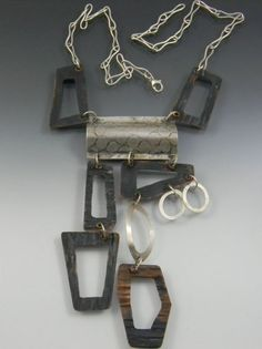 completely hand fabricated,sterling silver, painted copper,