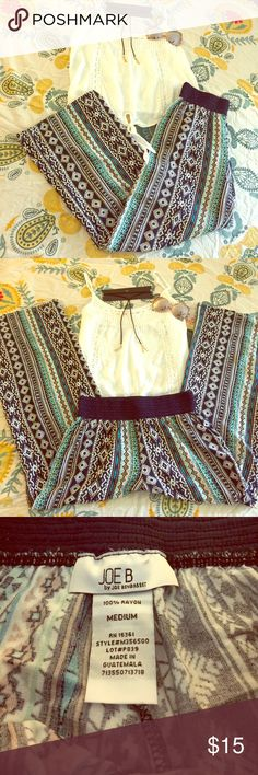 """Banded Tribal Pants The pants are perfection! The waist is elastic with crochet detailing, they are wide legged to give you almost a palazzo pant feel. They have pockets as well and the inseam measurement is approximately 30"""". Pants Wide Leg"""