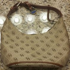 Smal Dooney purse Selling a small fabric Dooney purse in very good condition.  I bought it for myself and was too small for me so it's practically new. Great bargain. Dooney & Bourke Bags Shoulder Bags