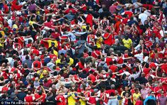 Mockery: Arsenal fans poked fun at the City supporters by doing the 'Poznan' celebration after the third goal