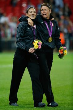 Hope Solo #1 and Abby Wambach #14 of the United States celebrate with the the gold medal after defeating Japan by a score of 2-1 to win the Women's Football gold medal match on Day 13 of the London 2012 Olympic Games at Wembley Stadium on August 9, 2012 in London, England.