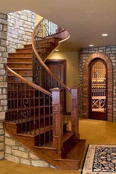 Lovely sweeping staircase into the wine cellar! Don't those stone accents jump out?  #winecellar #staircase #stone