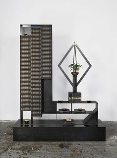 """Rashid Johnson   """"Death by Black Hole 'The Crisis'""""  (2010)  Steel, black soap, wax, books, shea butter, plant, space rocks, mirror, spray enamel, and stained wood  96 1/2 x 76 1/4 x 30 in. (245.11 x 193.675 x 76.2 cm)  Courtesy Gagosian Gallery  Image courtesy of the artist and David Kordansky Gallery, Los Angeles, CA"""