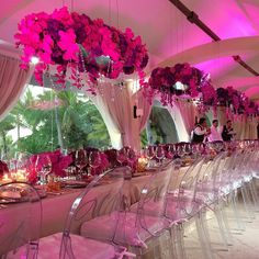 Very unique, gorgeous table setting with pops of pink and red.