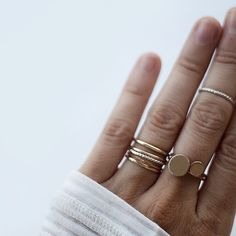 i love the idea of two different sized stones and lots of stackable bands for an engagement/wedding band