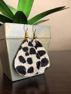 How fun are these cheetah drops with the hair on feature?!? They are genuine leather that have lots of character and texture. dainty drops: 2 inches assembled BiG drops: 2 3/4 inches assembled Available with silver or gold hooks. The Dainty Design keeps things smaller, easier for