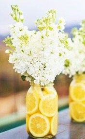 Stock or delphinium for the white flower would add more height.  Simple mason jar with lemons or something else as a vase.