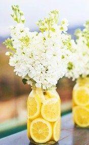 white flowers in mason jars, centerpiec, center pieces in mason jars, garden parties, lemon center piece mason jar, lemon lime bridal shower, center pieces with mason jars, green flowers, mason jar lemon flowers