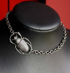 Simple Asymmetrical  silver color short necklace with Egyptian scarab beetle. YOUR MINE NOW