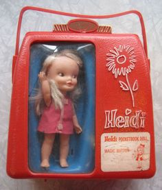 Push her tummy and her arm goes up in a wave. From the 1960s. One of my favorite dolls!!!!