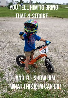 Our little motocross racer loves his KTM!!