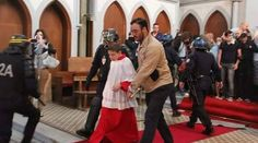 'Happening now in France, 05/08/2016' Le Pen's fury as riot police DRAG Christians out of church