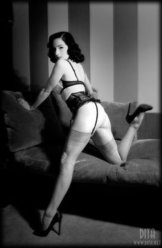"""""""Angel's Kiss"""", a retro-glamour photoshoot with Dita Von Teese and her Louboutin shoes. Photographed by Silvercanvas. Outfit by Rigby and Peller. More pictures on www.dita.net #DitaVonTeese #Stockings #Louboutin"""