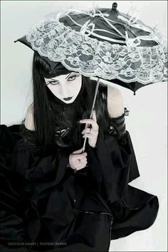 Goth:  Goth girl with lacy parasol.