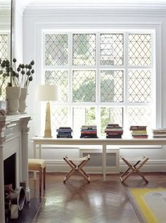 Like the feel of this space, including the layout and spacing of the books and camp stools.