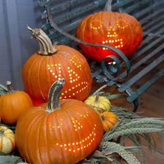 Powered-Up Pumpkins.  Whip out the power drill to carve intricately detailed pumpkins. These faces were sketched first, then a power drilled to make evenly spaced holes along the drawn lines.
