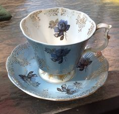 Vintage Royal Albert Tea Cup and Saucer Blue Roses Background Gold Designs