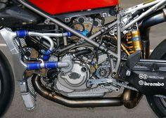 Ducati 998R F01 Engine. Magnesium heads, Carbonfibre airfilter tubes, Samco hoses. Titanium exhaust.  Nothing exotic then.