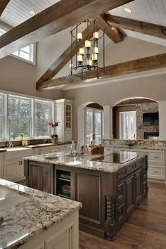 i wish i could do exposed beams in my kitchen! I love the light cabinets and dark island look