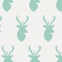 Mint Deer Head Fabric by the Yard from Carousel Designs.  Majestic deer adorn this soft 100% cotton fabric. Featuring a fabulous shade of mint green it's the perfect coordinate for our Mint Antlers fabric or use alone to create your special nursery.