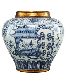LARGE BLUE AND WHITE JAR The jar is of globular-shaped and is decorated with a small porch occupied by a master and a servant surrounded by trees, grass and ruyi clouds. Overall the jar is of light blue colour tone. The neck of the jar is of golden colour.  16 1/2 in. tall. Ming Dynasty