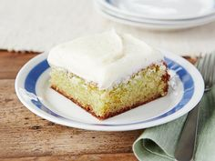 Lime-flavored gelatin gives the tangy taste to this for-a-crowd Key Lime Cake. It's soaked in a Key lime juice glaze and topped with cream cheese frosting.