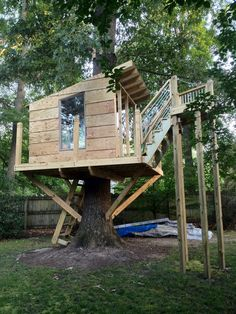 My hubby's latest project in the works. Tree house with zip-line.