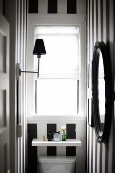 Black and white wall paper in the bathroom!