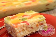 """A delightful and popular Filipino dessert """"Crema de Fruta"""".  Crema de Fruta is a  layered sponge cake or lady finger also known as """"Broas"""" made with a creamy custard filling as """"Crema"""", topped with drained fruit cocktail called """"Fruta"""" and glazed with clear jelly to make it more sophisticated and elegant."""