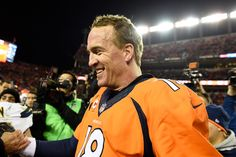Peyton Manning (18) of the Denver Broncos smiles as he shakes hands after the Broncos win. The Denver Broncos played the San Diego Chargers at Sports Authority Field at Mile High in Denver, CO on January 3, 2016. (Photo by Joe Amon/The Denver Post)