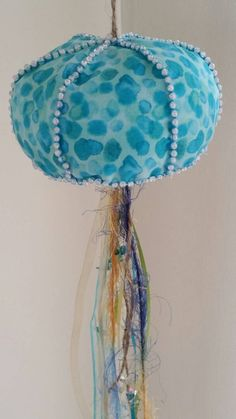 Check out this item in my Etsy shop https://www.etsy.com/listing/214737854/unique-hanging-jellyfish