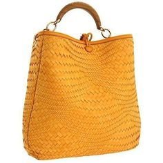 f9fe9a1a0d0d7 The Salvatore Ferragamo Ceyla Handbag is a tote-style woven leather retro  bag with a single top handle