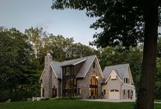 This stunning Belgian farmhouse features contemporary styling by Brooks and Falotico Associates, located in the countryside of New Canaan, Connecticut.