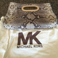 Authentic Michael Kors clutch Authentic Michael Kors snakeskin clutch. This sexy clutch measures 13' x 8'. This bag is in perfect condition with no damage anywhere. Comes with dust bag. Smoke free home MICHAEL Michael Kors Bags Clutches & Wristlets