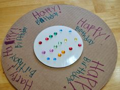Make a shield using cake boards for How to Train your dragon party